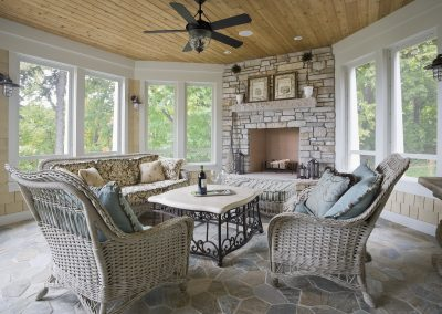 Three season porch with stone fireplace and floor